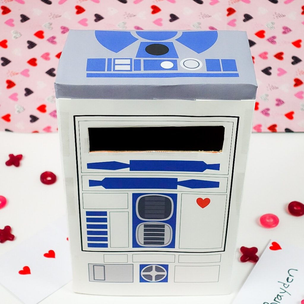 If you are looking for Valentine Mailbox Ideas and Valentine's Crafts this awesome Star Wars R2D2 Valentine Mailbox is just the start.