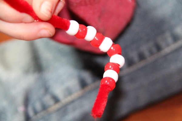 Valentine's Day craft for kids- Bend the end to hold the beads