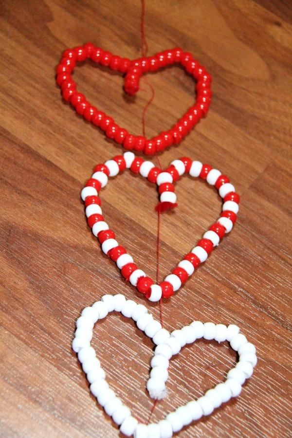 Vanetine's Day craf tfor preschoolers- tie the hearts together