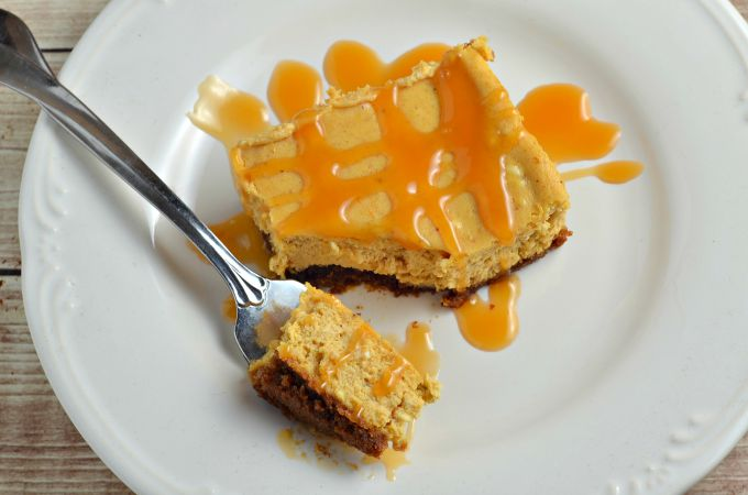 Pumpkin cheesecake bars topped with caramel to make your heart sing!